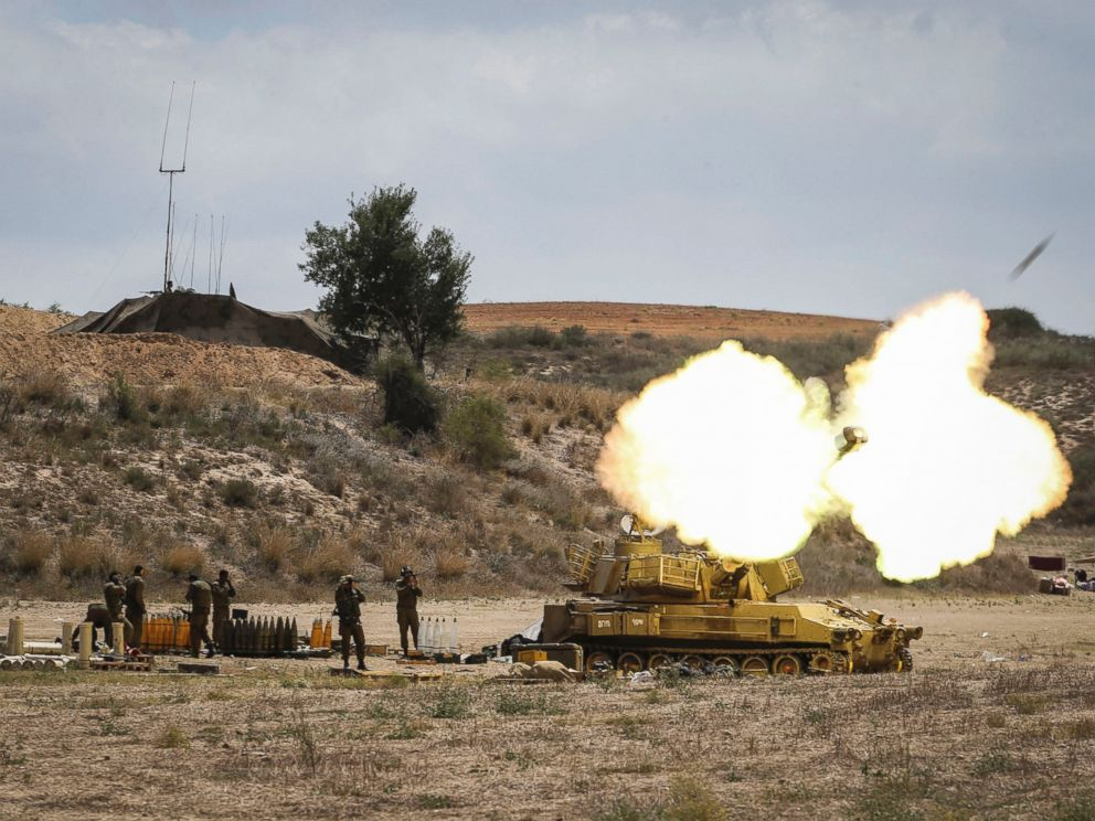 PHOTO: An Israeli artillery shell is fired at the border with Gaza, July 18, 2014, near Sderot, Israel.