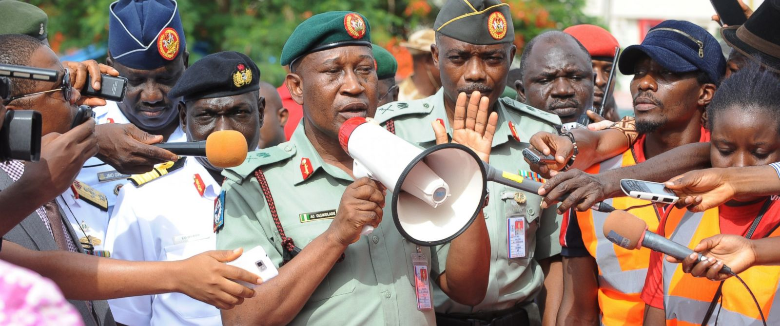 PHOTO: Nigerian Defense spokesman Major General Chris Olukolade, center, speaks to civil society groups protesting the abduction of hundreds of girls during a rally pressing for the girls release in Abuja, May 6, 2014.