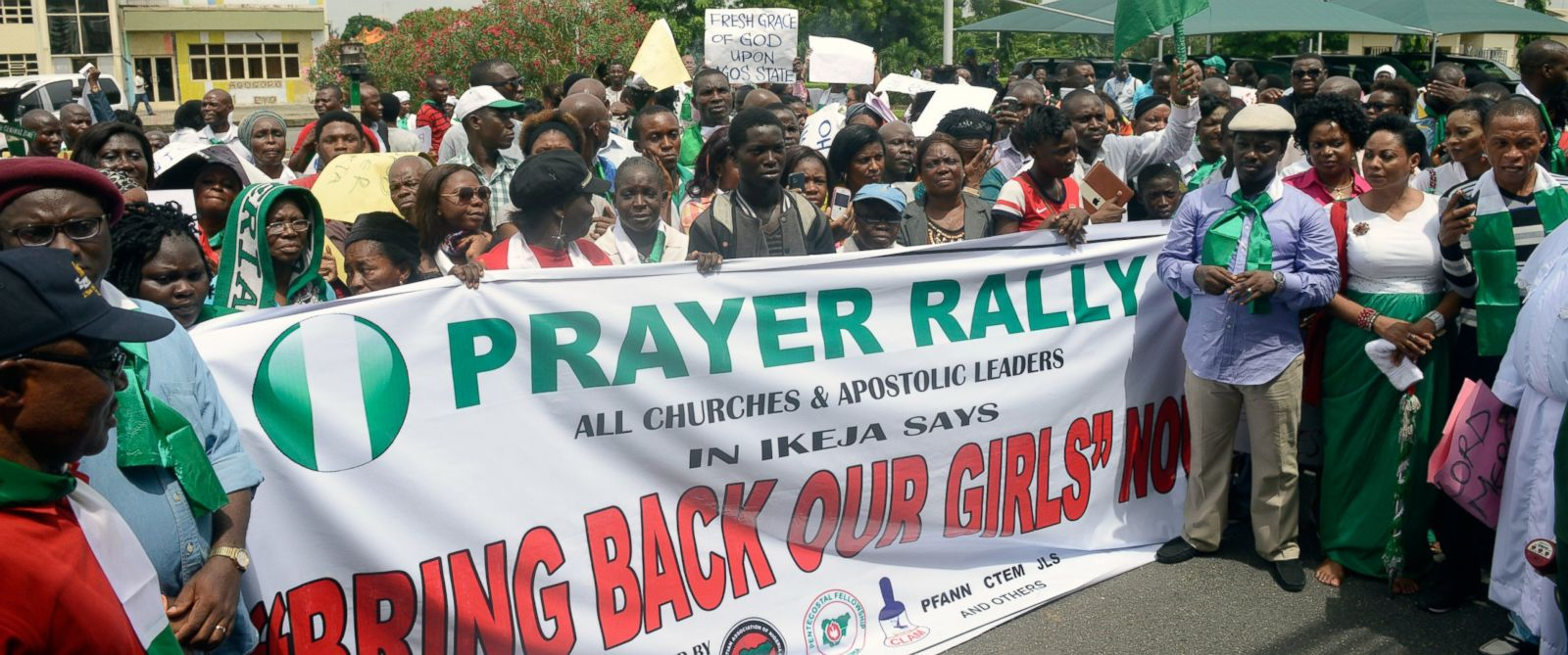 PHOTO: Christian groups carry a banner as they take part in a demonstration to press for the release of missing Chibok school girls in Lagos, May 12, 2014.