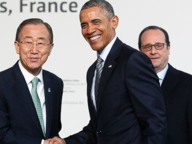 PHOTO:United Nations Secretary General Ban Ki-moon shakes hand with President Barack Obama as French President Francois Hollande looks on, upon their arrival for the opening UN conference on climate change COP21, Nov. 30, 2015 at Le Bourget, France.