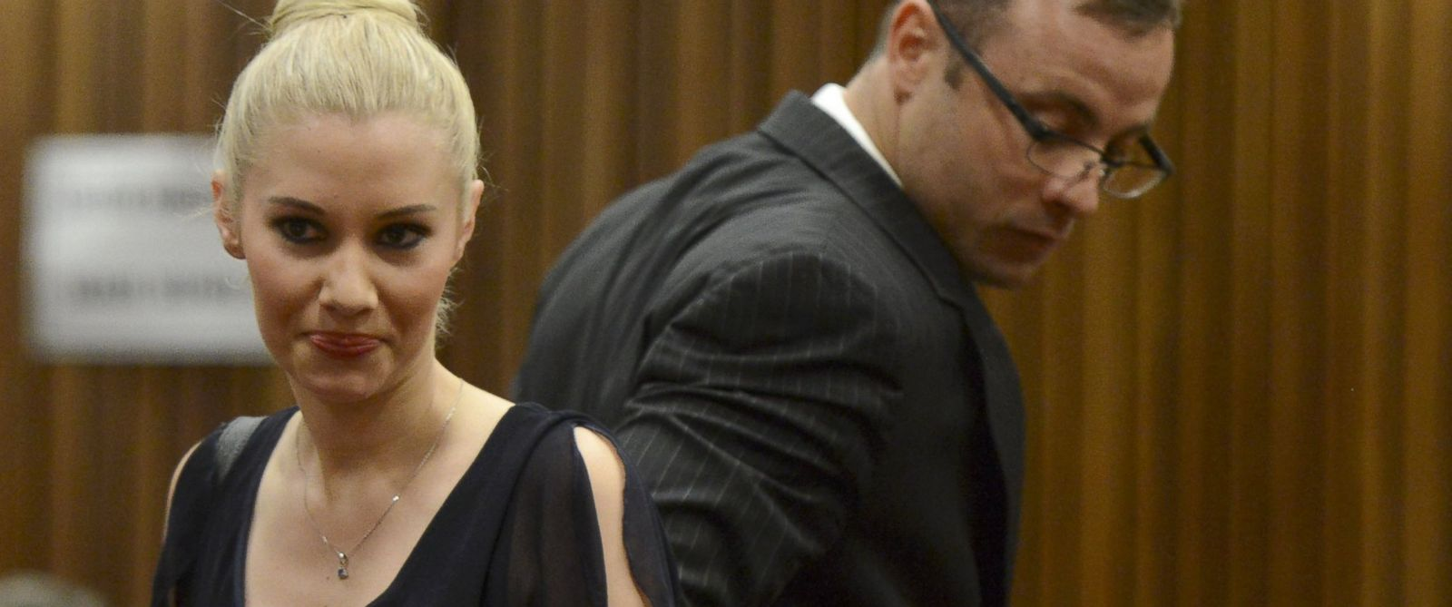 PHOTO: Oscar Pistorius makes his way past his ex girlfriend Samantha Taylor as he arrives in the Pretoria High Court for sentencing in his murder trial, Oct. 14, 2014, in Pretoria, South Africa.