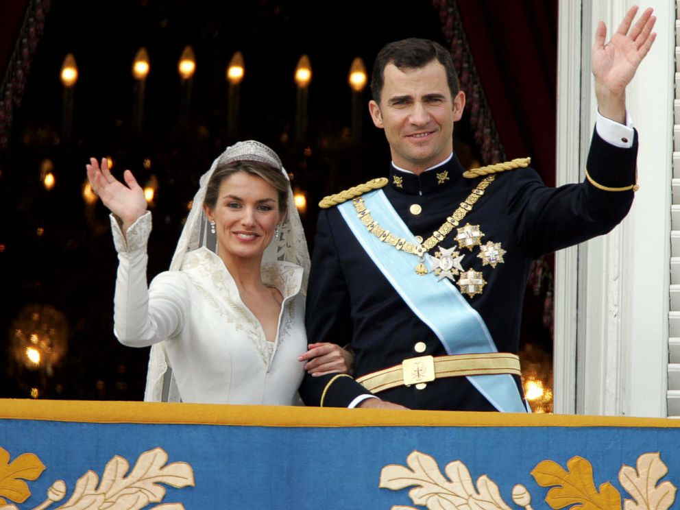 PHOTO: Princess of Asturias, Letizia Ortiz and her husband Spanish Crown Prince Felipe of Bourbon wave to the crowd after their their wedding ceremony, May 22, 2004.