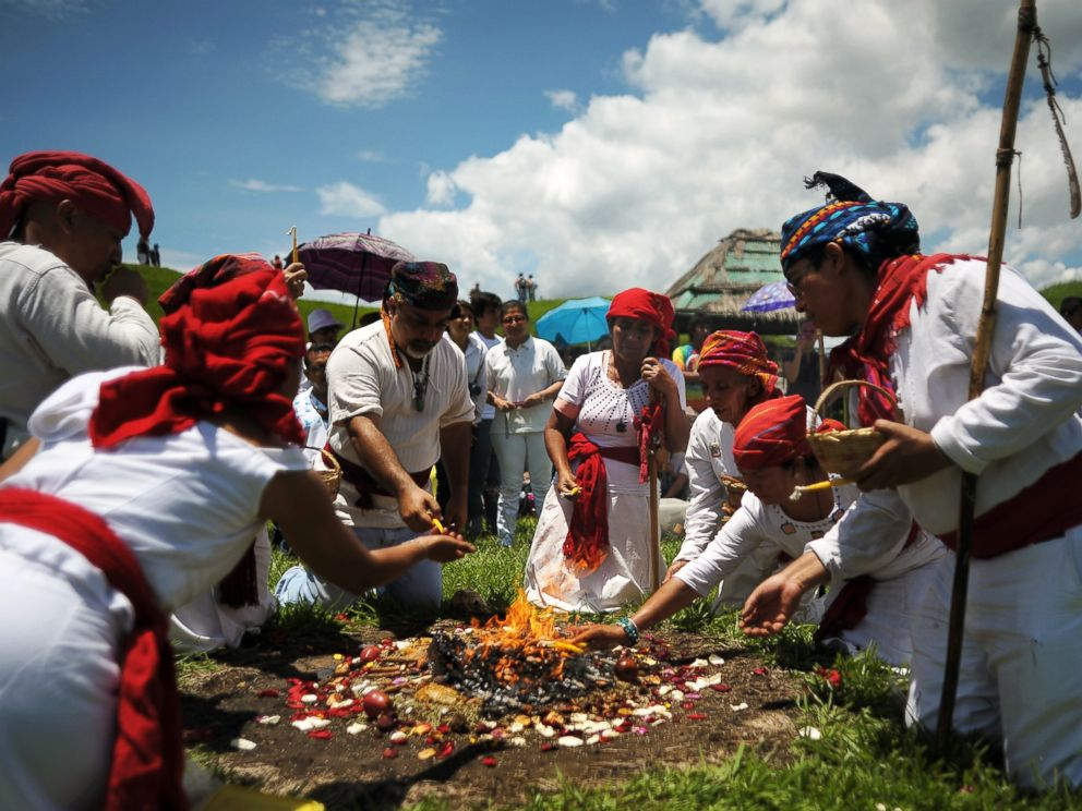 PHOTO: Members of the Mayan Priest Council make an offering during a ceremony