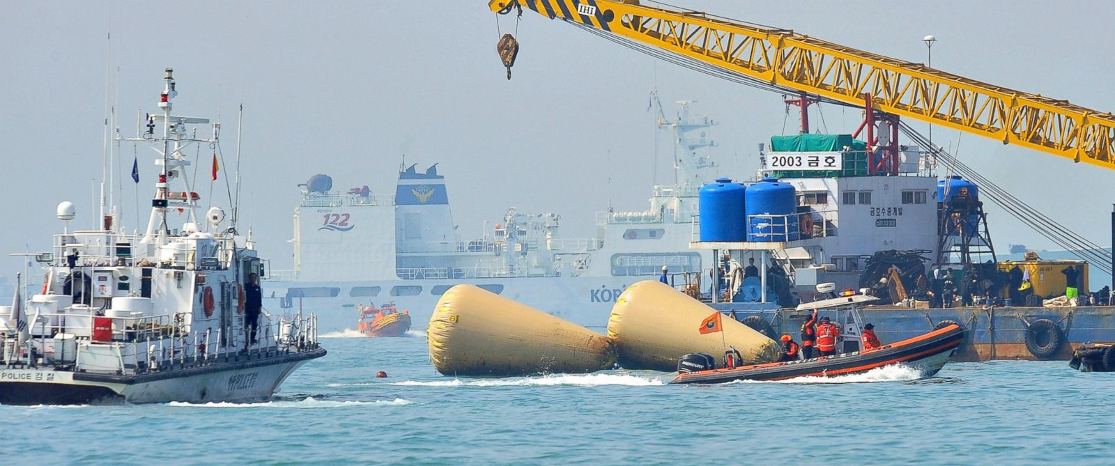 PHOTO: South Korean rescue teams take part in recovery operations at the site of the sunken Sewol ferry, marked with buoys, off the coast of the South Korean island of Jindo, April 23, 2014.
