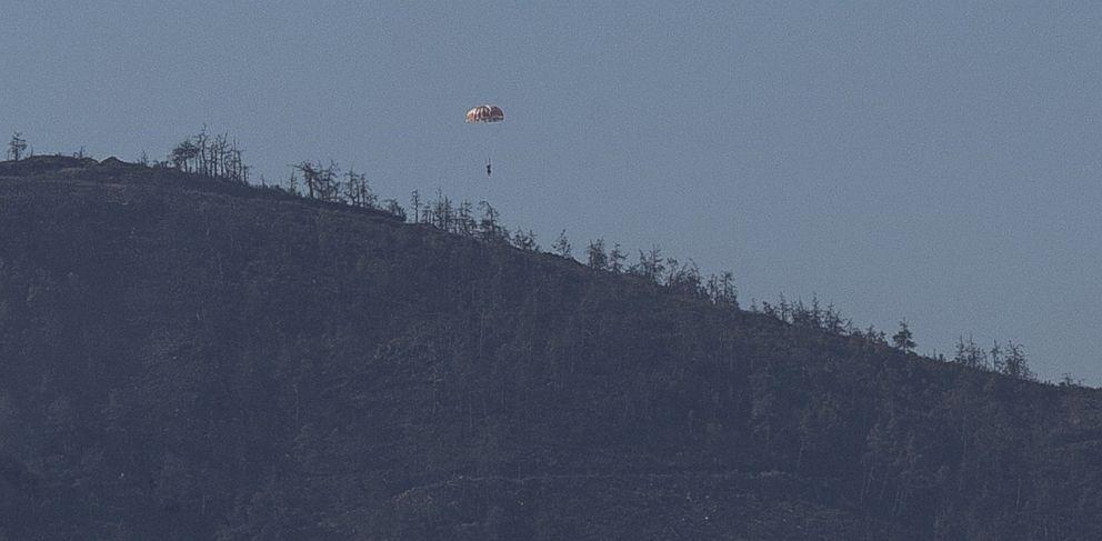 PHOTO: A Russian pilot parachutes out of a warplane which went down in Syrias northwestern Turkmen town of Bayirbucak near Turkeys border, Nov. 24, 2015.