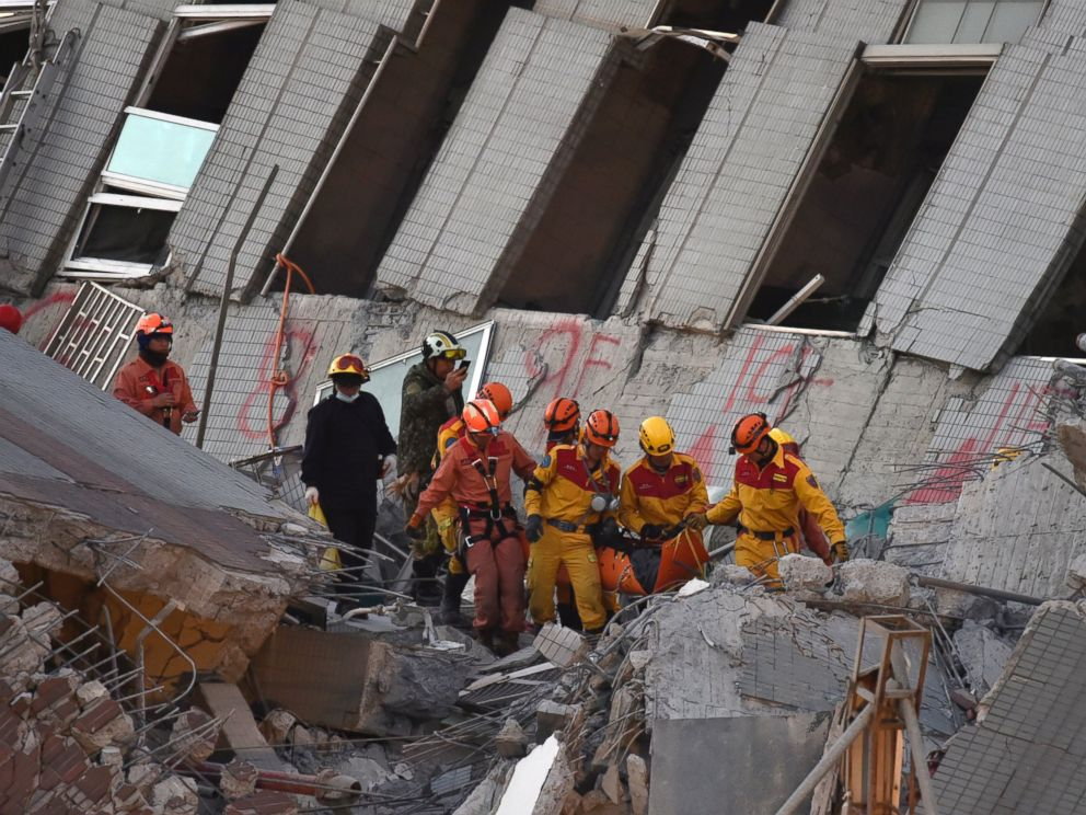 PHOTO: Rescue personnel bring down a Vietnamese national, identified as 28-year old Chen Mei-Jih, to safety after she was extracted from a building which collapsed in the earthquake in the southern Taiwanese city of Tainan, Feb. 8, 2016.