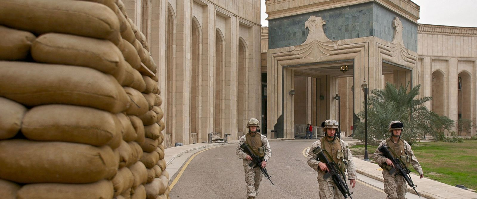 PHOTO: U.S. Marines walk past the front of the American Embassy, Feb. 6, 2007, in Baghdad, Iraq.