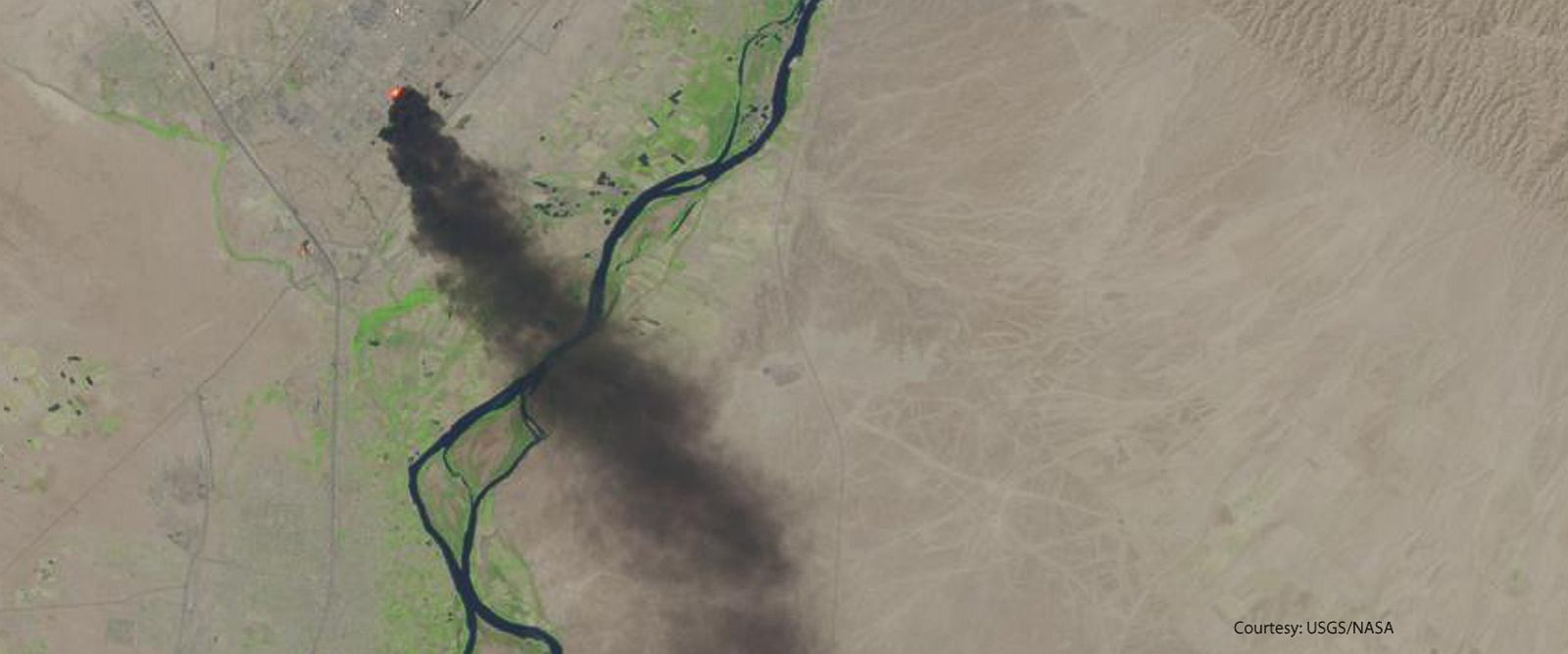 PHOTO: This photo from the U.S. Geological Survey and NASA shows a satellite view of smoke billowing from the Baiji North refinery complex on June 18, 2014 in Baiji, about 130 miles north of Baghdad, Iraq.