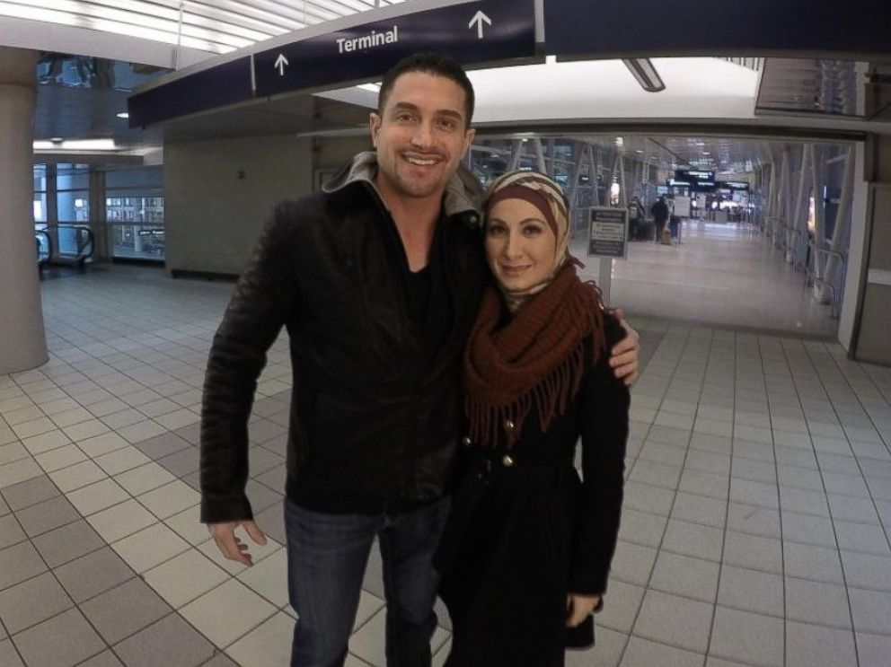PHOTO: Sarah Hekmati and her husband Dr. Ramy Kurdi in the Detroit airport enroute to Germany to meet Hekmatis brother, Amir Hekmati, who was released from Iran.