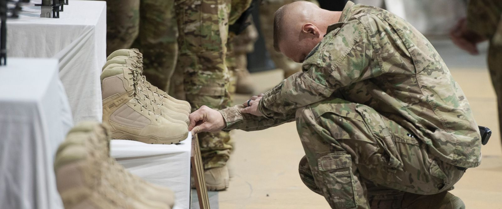 PHOTO: Service members from several units at Bagram Air Field, Afghanistan, pay their respects during a fallen comrade ceremony held in honor of six Airmen, Dec. 23, 2015.