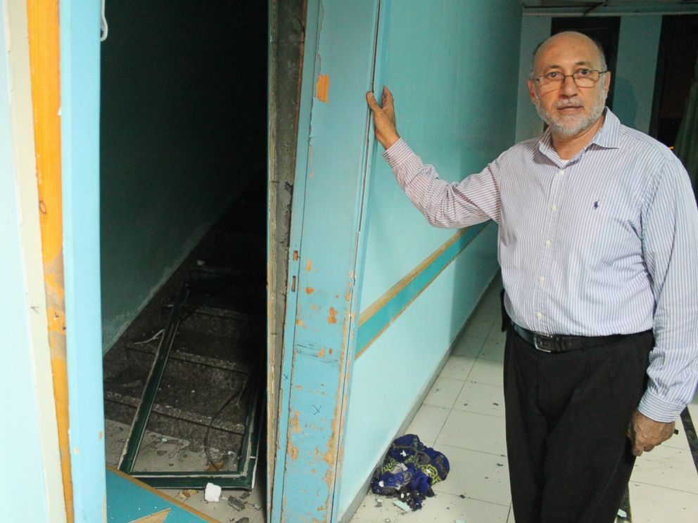 PHOTO: Basman Alashi, executive director of El-Wafa Hospital in eastern Gaza City, shows the damage caused by an Israeli projectile that struck the hospitals fourth floor Friday evening, demolishing a wall and damaging doors and windows.