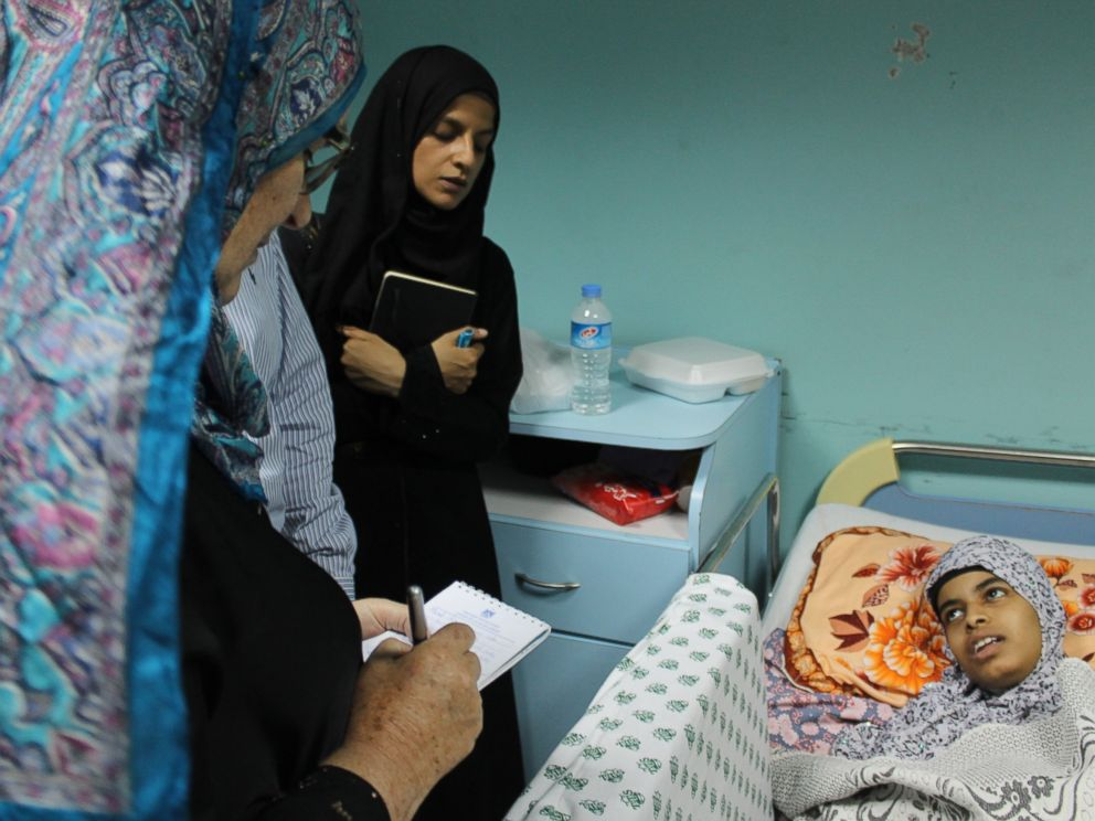 PHOTO: International activists speak with a patient hours after an Israeli projectile struck the hospitals fourth floor Friday evening, demolishing a wall and damaging doors and windows.