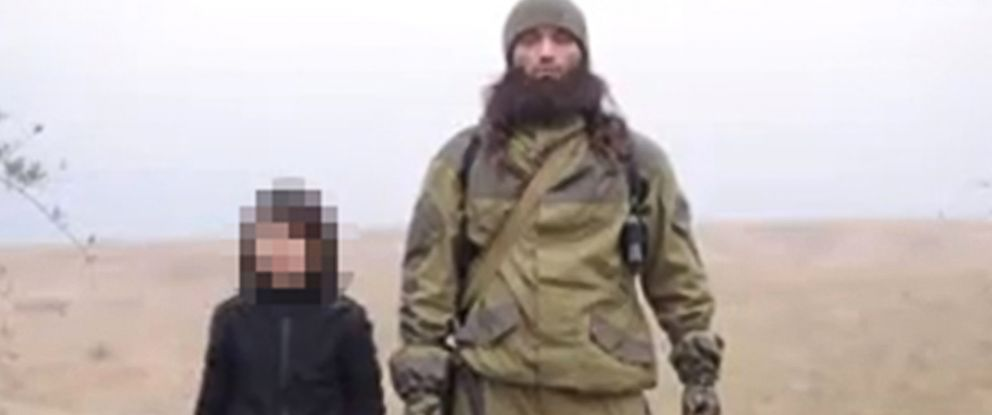 """PHOTO: A video released by ISIS Jan. 13, 2015 claims to show a child killing two Russian """"spies."""""""