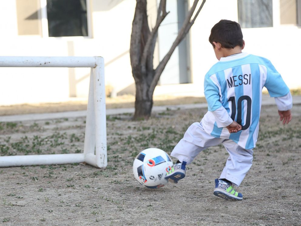 PHOTO: As of today, Murtaza Ahmadi can proudly show off the new signed jerseys and a football he received from UNICEF Goodwill Ambassador Leo Messi. Murtazas photo went viral after he was pictured wearing a soccer jersey made from a plastic bag.