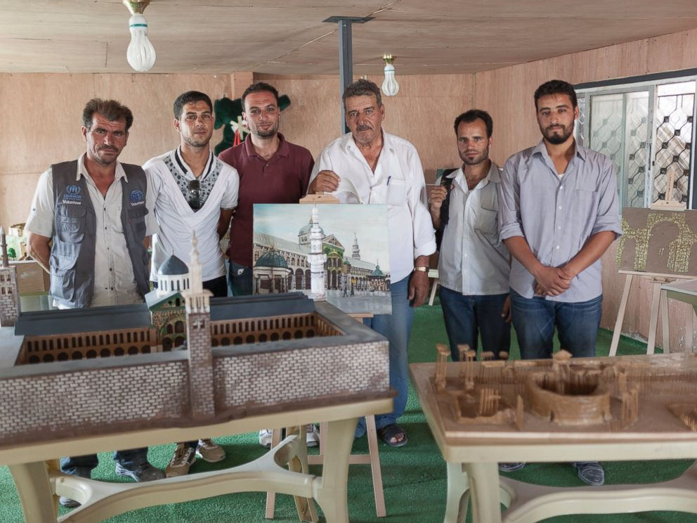 PHOTO: The group of artists in front of their artwork. We chose this project to highlight what is happening in Syria, because many of these sites are under threat or have already been destroyed.
