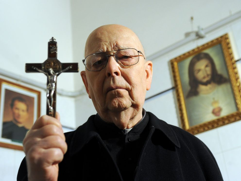 PHOTO: Italian priest exorcist Father Gabriele Amorth poses in his office in Rome, Feb. 16, 2012.