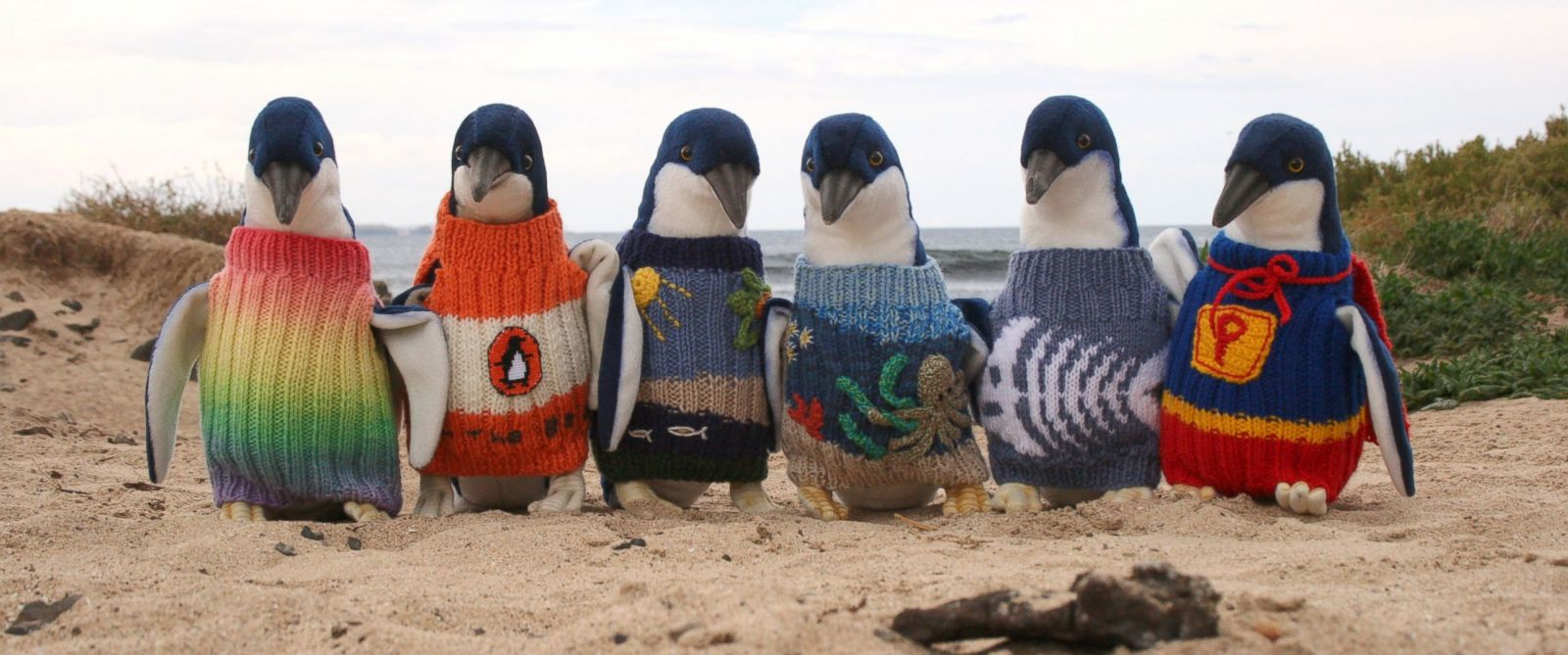 PHOTO: The winning sweaters of a knitting competition put on by the Penguin Foundation Knits for Nature program are displayed on stuffed toy penguins in this March 2014 file photo.