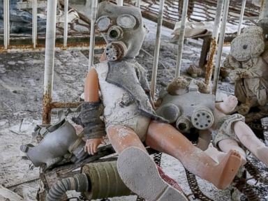 PHOTO: A doll in a childrens gas mask is seen amongst beds at a kindergarten in the abandoned city of Pripyat near the Chernobyl nuclear power plant in Ukraine March 28, 2016.