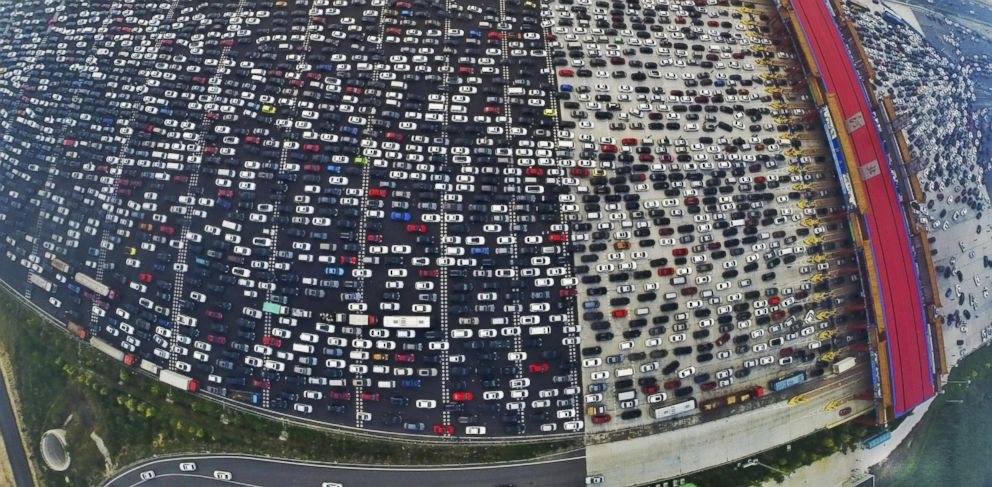 PHOTO: Vehicles are seen stuck in a traffic jam near a toll station as people return home at the end of a week-long national day holiday, in Beijing, Oct. 6, 2015.