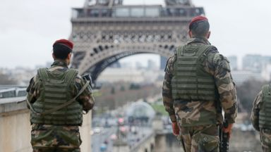 """PHOTO: French soldier patrols near the Eiffel Tower in Paris as part of the highest level of """"Vigipirate"""" security plan after a shooting at the Paris offices of Charlie Hebdo January 9, 2015."""