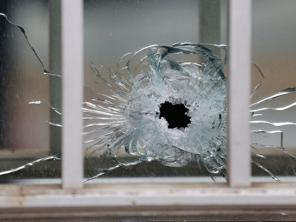 PHOTO: A bullets impact is seen on a window at the scene after a shooting at the Paris offices of Charlie Hebdo, a satirical newspaper, Jan. 7, 2015.