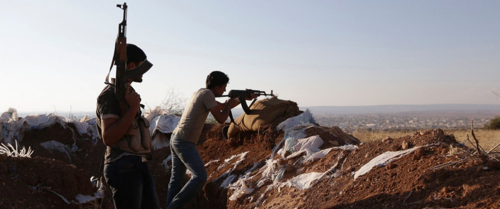 PHOTO: Armed Free Syrian Army fighters stand on one of the frontlines of Wadi Al-Dayf camp in the southern Idlib, Syria, countryside, Sept. 14, 2014.