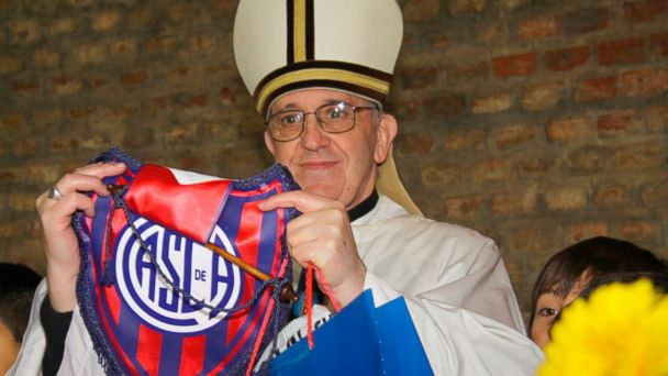 PHOTO: Argentine Cardinal Jorge Bergoglio poses with a jersey from the San Lorenzo soccer club, of which he is known to be a fan, in this undated handout photograph distributed by the club, March 13, 2013, after Bergoglio was elected as the new Pope.