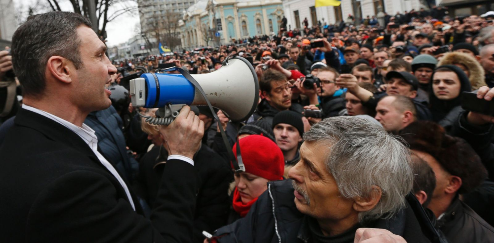 PHOTO: Ukrainian opposition leader and head of the UDAR (Punch) party Vitaly Klitschko (L) addresses anti-government protesters outside the Ukrainian Parliament building in Kiev, Feb. 22, 2014.