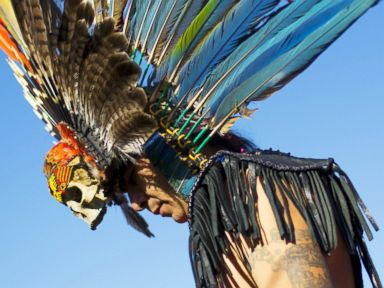 PHOTO: A reveller gets ready to dance during a pow-wow celebrating the Indigenous Peoples Day Festival in Randalls Island, New York, Oct. 11, 2015.