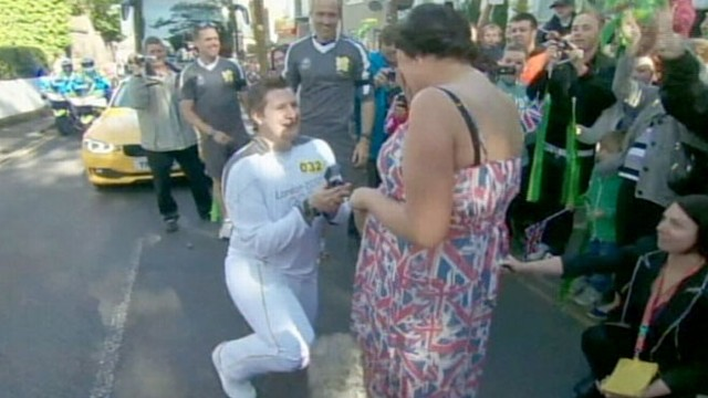 VIDEO: Olympic Torch Bearer Stops to Propose to Girlfriend