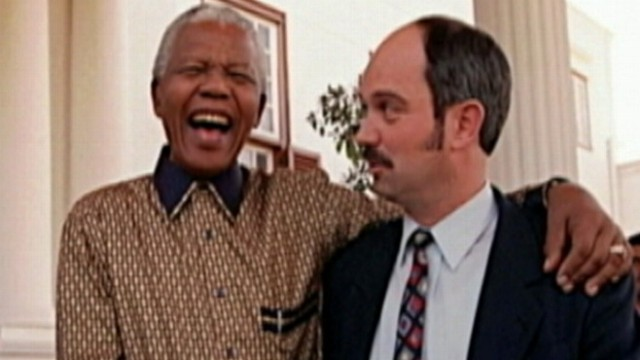 VIDEO: The unlikely friendship between Mandela and the man who kept him prisoner.
