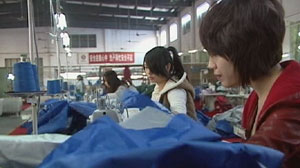 PHOTO Young workers assemble umbrellas in a factory in Songxia, China, Nov. 2010.