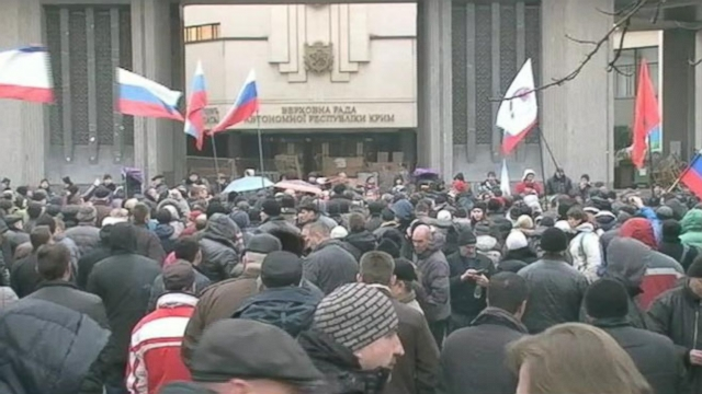 Pro-Russia supporters gathered outside the central parliament building in the Crimean region.
