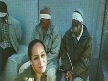 Video: Solider post pictures with Palestinian prisoners.