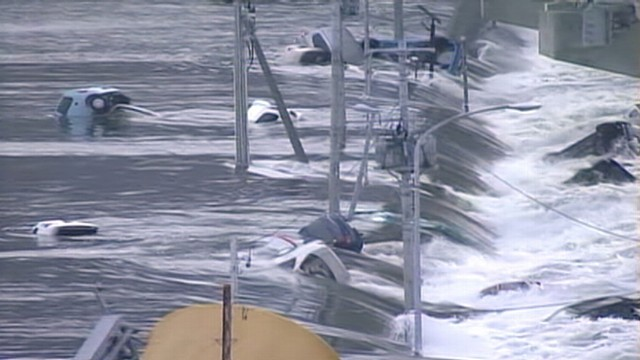 VIDEO: Surging waters sweep vehicles under a road bridge in Miyagi Prefecture, Japan.