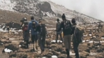 Seven disabled veterans and four wingmen tackle rugged terrain and harsh weather on their hike up Mt. Kilimanjaro.