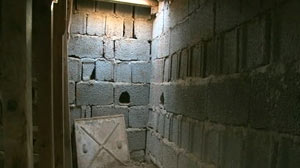 PHOTO: Shown here is the underground prison where rebels found and freed prisoners that were left there for dead.