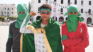 PHOTO pro-Ghadafi supporters in Tripolis Green Square wearing the countrys signature color.