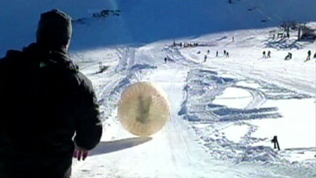 VIDEO: Denis Burakov was riding in a giant plastic ball that rolled down a gorge at a Russian ski resort.