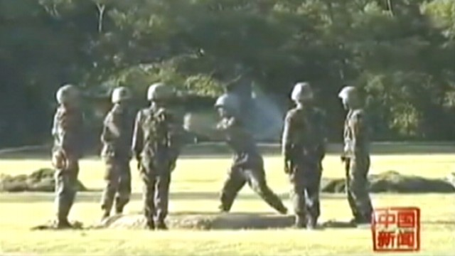VIDEO: Video purports to show soldiers passing grenade right before explosion.