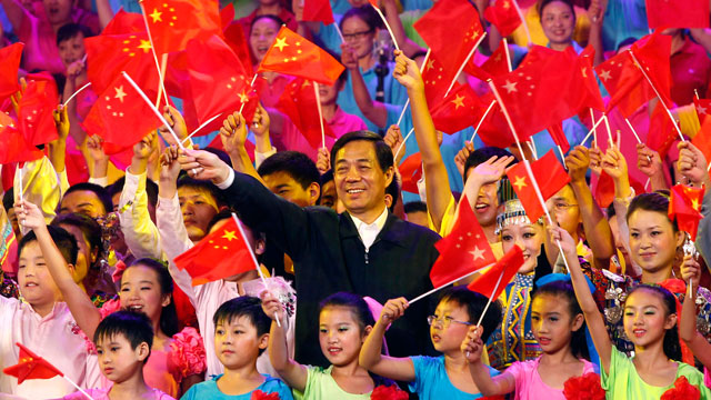 "PHOTO: In this photo taken on Sept. 29, 2011, Bo Xilai, party boss of Chongqing, center, and others wave Chinese flags during a gathering to promote the singing of ""red songs"" in southwest China's Chongqing Municipality."
