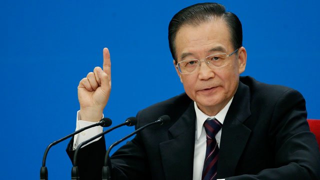 PHOTO: Chinese Premier Wen Jiabao gestures during a press conference after the closing session of the annual National People's Congress held in Beijing's Great Hall of the People, in China, March 14, 2012.