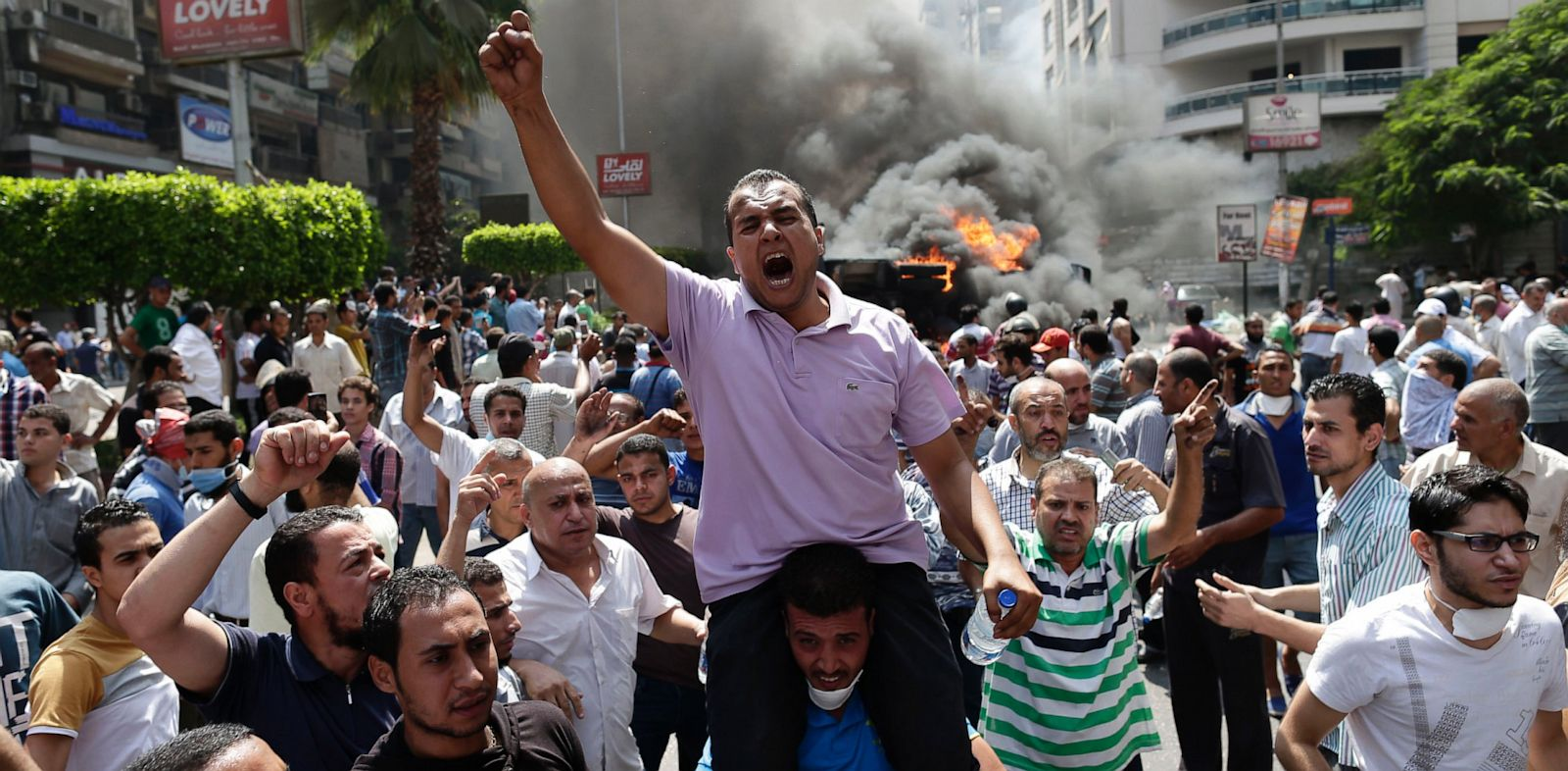 PHOTO: Supporters of Egypts ousted President Mohammed Morsi chant slogans against Egyptian Defense Minister Gen. Abdel-Fattah el-Sissi during clashes with Egyptian security forces in Cairos Mohandessin neighborhood, Egypt, Wednesday, Aug. 14, 2013.