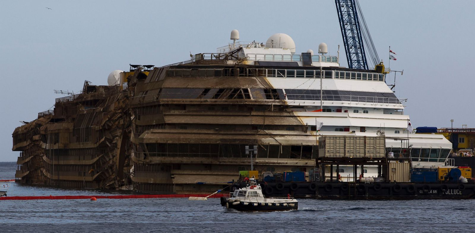 PHOTO: The Costa Concordia is seen after it was lifted upright, on the Tuscan Island of Giglio, Italy, early Tuesday morning, Sept. 17, 2013.
