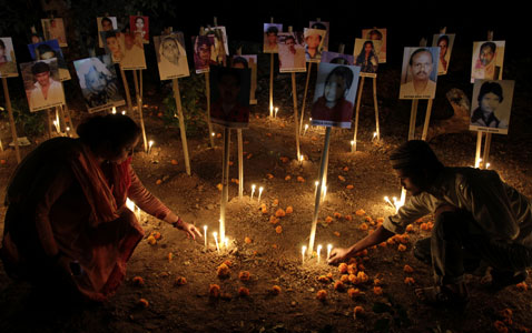 ap India Gujarat Riot Anniversary nt 120224 wblog Today in Pictures: Bolivia Disabled Protest, Kerobokan Prison Riot, and Myanmar Democracy