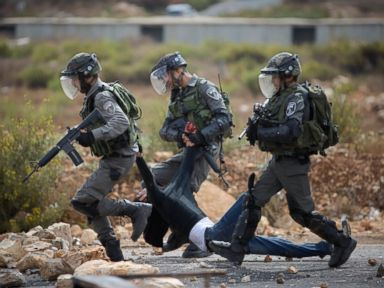 PHOTO: Israeli soldiers carry a wounded Palestinian during clashes between the Israeli military and Palestinians, near Ramallah, West Bank, Oct. 7, 2015.