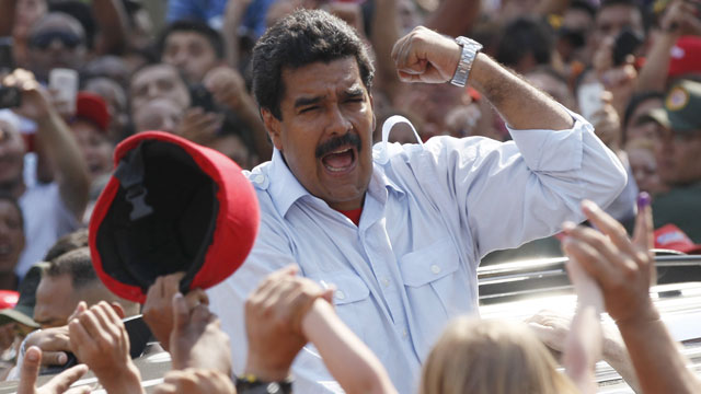PHOTO: Venezuelas interim President Nicolas Maduro gestures to supporters as he leaves a polling station after voting in the presidential election in Caracas, Venezuela, Sunday, April 14, 2013.