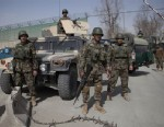 PHOTO:Afghan Army soldiers take position at the gate of the Afghan Defense Ministry after a suicide bomber on a bicycle struck outside the ministry, killing at least nine Afghan civilians as U.S. Defense Secretary Chuck Hagel visited Kabul, Afghanistan,