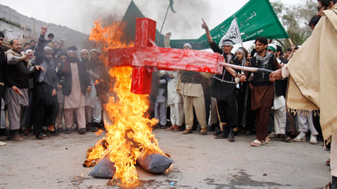 ap afghan burning cross ss thg 120313 wblog Today in Pictures: Cheltenham Horse Race, Gaza Mourns, Afghanistan Protests, and Turtles