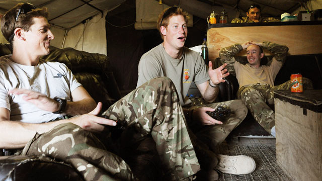 PHOTO: Britain's Prince Harry, center, reacts as he plays computer games with his fellow Apache Helicopter crew, during his 12 hour VHR (very high ready-ness) shift at the British controlled flight-line in Camp Bastion southern Afghanistan, Nov. 3, 2012.